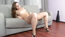 Hot naked gal on high heels fucking her pussy with a long dildo deep