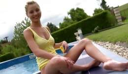 Blonde lovebird is following to a pool and she is lustful her hairless pussy